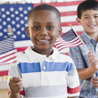 Boys holding small American flags