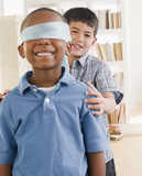 Boy spinning friend wearing blindfold
