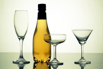 alcohol bottle with crystal glass on white background.