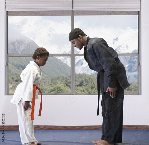 African American boy practicing karate with sensei