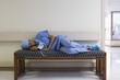 Black surgeon napping on hospital bench