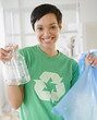 Mixed race woman recycling bottles