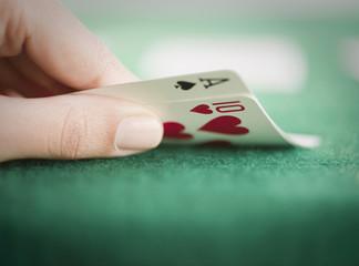 Hand revealing poker cards