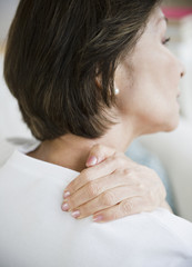 Japanese woman rubbing neck and shoulders