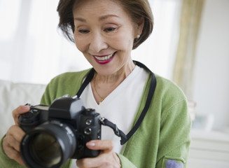 Japanese woman holding digital camera