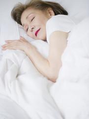 Japanese woman sleeping in bed