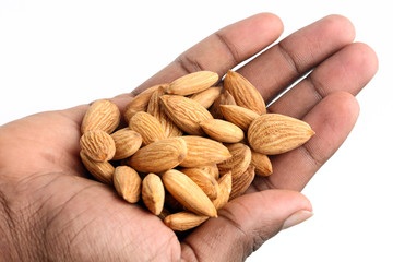 Hand with almonds