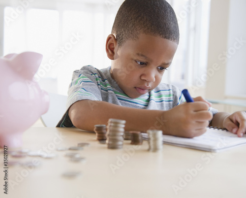 African American boy counting coins