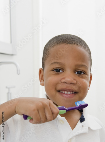 African American boy brushing teeth