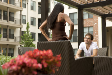 Couple talking on patio