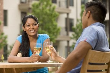 Couple drinking white wine outdoors