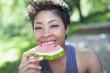 Black woman eating watermelon