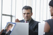 Business people video conferencing with laptops and digital tablet