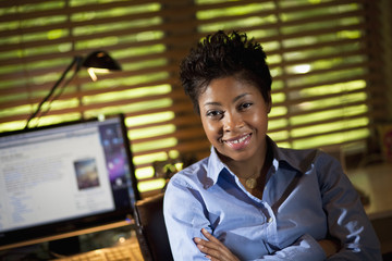 Smiling Black businesswoman in office