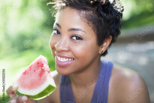 Black woman eating watermelon