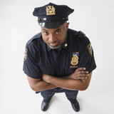 African American policeman with arms crossed