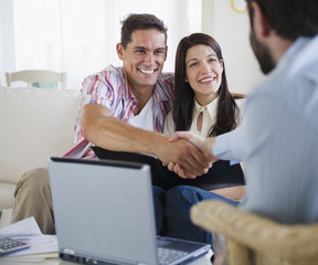 Couple greeting finance advisor