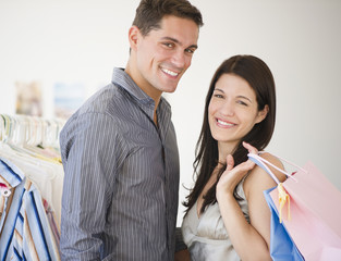 Smiling couple shopping for clothing together