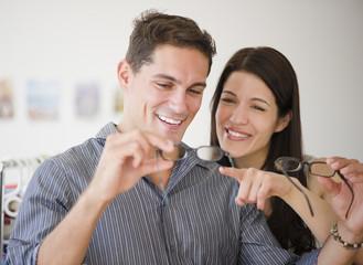 Smiling couple shopping for eyeglasses together