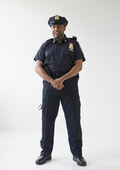 African American policeman with hands clasped