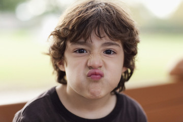 Puckering Hispanic boy