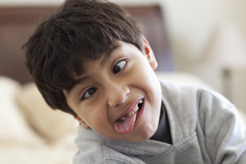 Hispanic boy making a face and sticking out tongue