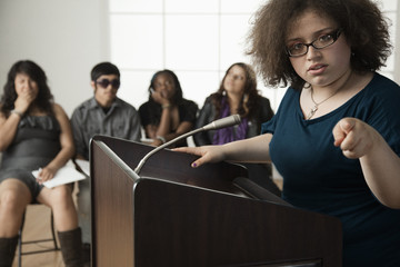 Teenage girl giving speech to classmates