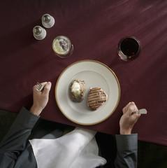 Caucasian woman preparing to eat meat and potatoes