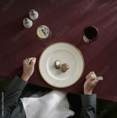 Caucasian woman about to eat tiny portion of meat and potatoes