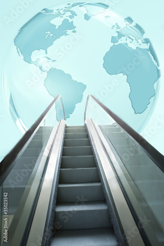 """Large, blue glass globe above escalator"""