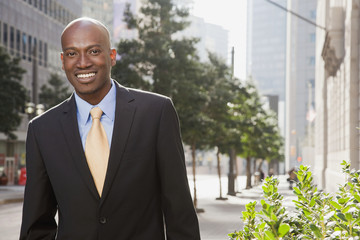 African American businessman standing outdoors
