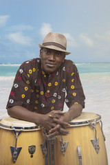 African American man leaning on drums