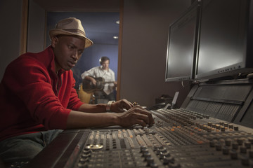 African American man working at audio control panel
