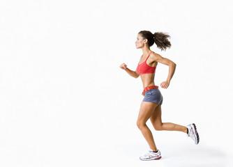 Hispanic woman in sportswear running