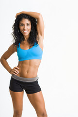 Mixed race woman in sportswear with arms raised