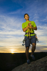 Hispanic man preparing for rock climbing