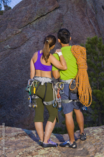Couple preparing for rock climbing