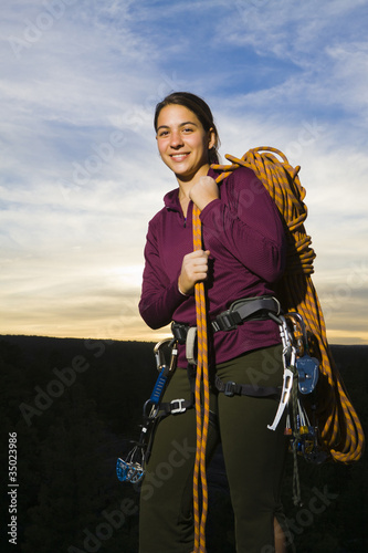 Caucasian woman preparing for rock climbing