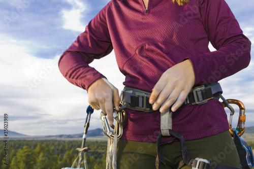 Caucasian woman preparing for rock climbing