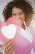 African American woman holding valentine