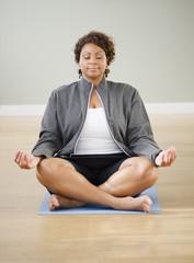 African American woman practicing yoga