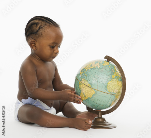 African American baby looking at globe