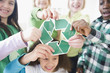 Children holding green recycling symbol