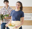 Couple carrying vegetables together