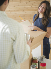 Couple packing boxes together