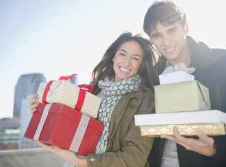 Couple carrying Christmas gifts