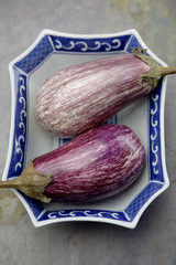 Chinese eggplants in bowl