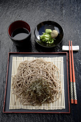 Asian noodles on plate with chopsticks