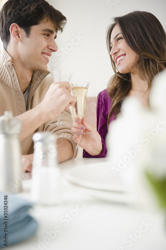 Smiling couple toasting with Champagne