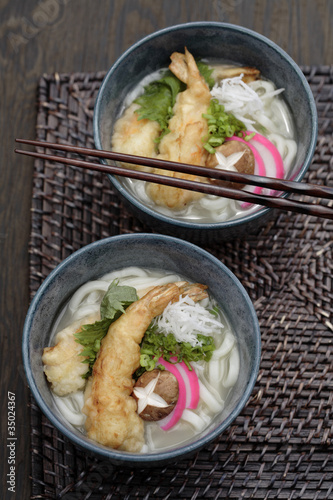 Udon noodle soup and tempura battered prawns